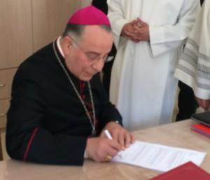 Archbishop Piccheiri signing petition